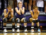 The Midland Christian Academy volleyball bench looks on in the final moments of the match as they trail Trinity Tuesday, Oct. 9 at Midland Christian.