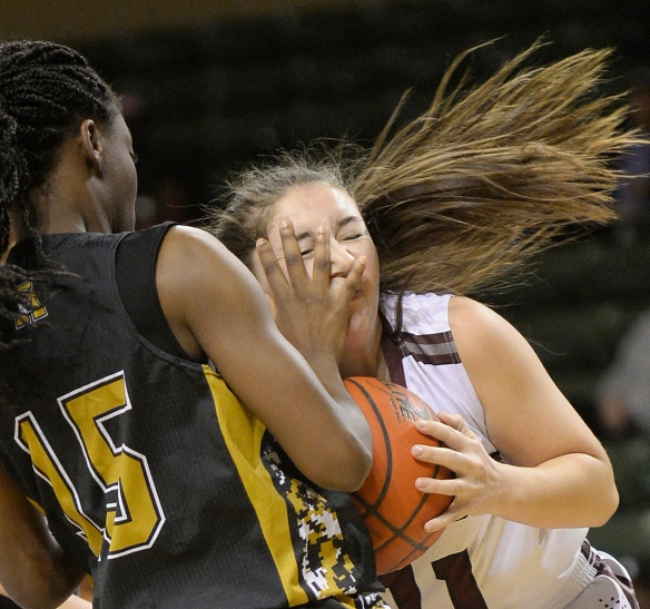 Lee's Madi Leavitt (11) comes down with a rebound against Abilene's Dakkia Morris (15) on Friday, Feb. 5, 2016, at Chaparral Center.