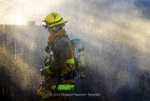 A Midland firefighter walks through the mist from a fire hose after a blaze destroyed a trailer home near the intersection of West County Road 137 and Rankin Highway Jan. 30, 2013. James Durbin/Reporter-Telegram