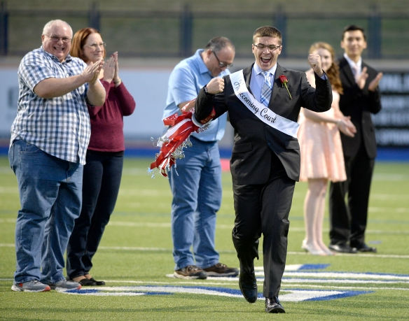 Lee High's Andrew Floyd reacts after being named homecoming king during halftime of the homecoming football game against Odessa High on Friday, Oct. 16, 2015, at Grande Communications Stadium.