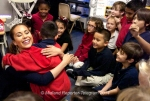 Miss Texas Monique Evans gets a hug from Chapo Valenzuela while visiting Mrs. Champagne's second grade class at Washington Math and Science Institute on Thursday. The Midland County Public Library brings Miss Texas to the Permian Basin each year. James Durbin/Reporter-Telegram