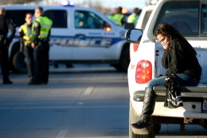 A bystander reacts on the scene of a fatal wreck involving a motorcyclist who evaded a police traffic stop before crashing into a pickup truck near the intersection of Lamesa Rd and Garden Lane.