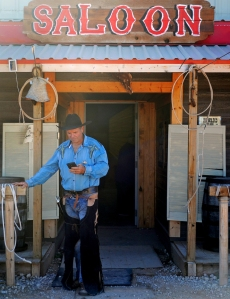 "Ricky Hickey, dressed in old west cowboy attire, checks his phone outside the Saloon on Wednesday, Nov. 16, 2016 at the Old Miner's Maze. Hickey is the owner of the Old Miner's Maze, an attraction he built on his property for familes and corporate outings that includes activities, rides, and a petting zoo in addition to the maze. ""People are building restaurants and people are building bars,"" said Hickey, ""but nobody is building for the kids.""