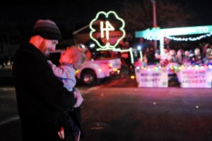 Wally Dunn holds his one-year-old son Jon Walter Dunn during the Rockin' Christmas parade on Saturday, Dec. 10, 2016. James Durbin/Reporter-Telegram